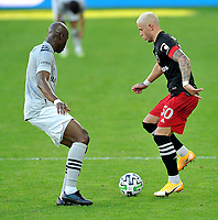 WASHINGTON, DC - NOVEMBER 8: Erick Sorga #50 of D.C. United battles for the ball with Rod Fanni #7 of Montreal Impact during a game between Montreal Impact and D.C. United at Audi Field on November 8, 2020 in Washington, DC.