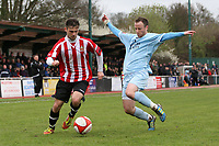 Joe Anderson of Hornchurch is tackled by Glenn Poole - AFC Hornchurch vs Billericay Town - Ryman League Premier Division Football at The Stadium, Upminster Bridge, Essex - 09/04/12 - MANDATORY CREDIT: Gavin Ellis/TGSPHOTO - Self billing applies where appropriate - 0845 094 6026 - contact@tgsphoto.co.uk - NO UNPAID USE