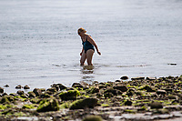WEATHER PICTURE WALES<br /> Pictured: A lady down the seafront in Mumbles, near Swansea, Wales, UK. Thursday 22 July 2021<br /> Re: High temperatures and sunshine has been forecast for most of the UK.