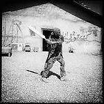An Afghan National Army soldier practices his cricket swing before heading out on patrol from Spin Ghar,  Panjwayi district, Kandahar, 30 April 2013. (John D McHugh)