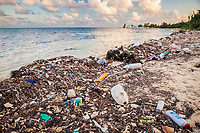washed up marine debris and plastic garbage, covering a beach, Turneffe Atoll, Belize, Caribbean Sea, Atlantic Ocean