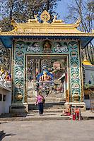 Nepal, Kathmandu, Swayambhunath.  Gateway to the Stairs leading up the Hill to the Stupa on Top.