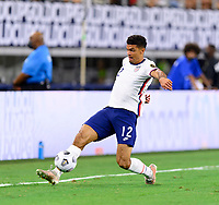 DALLAS, TX - JULY 25: Miles Robinson #12 of the United States keeps the ball from going out of bounds during a game between Jamaica and USMNT at AT&T Stadium on July 25, 2021 in Dallas, Texas.