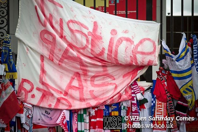 Scarves and a banner attached to the Shankly Gates at Anfield, part of the memorial to the 1989 Hillsborough stadium disaster where 96 Liverpool football fans lost their lives. Mourners and well-wishers have been leaving flowers, scarves and wreaths after the publication of a report the previous week by the Hillsborough Independent Panel which released new information about the tragedy. The Hillsborough Justice Campaign had been campaigning for a new inquest into the disaster for the last 23 years. Photo by Colin McPherson.