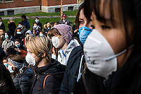 """Harvard students and community members gather for a """"die-in"""" protest outside of Memorial Church in Harvard Yard in Cambridge, Massachusetts, USA. Many protestors wore face masks with the phrase """"I can't breathe,"""" a reference to the last words of Eric Garner, a young black man who was killed by a police officer in New York City. The protest was meant to draw attention to the Garner's death and other recent police killings of black men, including the death of Michael Brown in Ferguson, Missouri."""