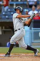 Charleston RiverDogs catcher Gary Sanchez #35 swings at a pitch during a game against the Asheville Tourists at McCormick Field on May 28, 2012 in Asheville, North Carolina . The Tourists defeated the RiverDogs 15-12. (Tony Farlow/Four Seam Images).