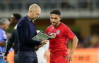 WASHINGTON, D.C. - OCTOBER 11: Manager Gregg Berhalter and Cristian Roldan #15 of the United States discuss his responsibilities before entering the field  during their Nations League game versus Cuba at Audi Field, on October 11, 2019 in Washington D.C.