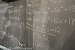 Education High School mathematics algebra equations on blackboard horizontal
