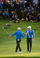 26.09.2014. Gleneagles, Auchterarder, Perthshire, Scotland.  The Ryder Cup, Day 1.  Rory McIlroy and Sergio Garcia celebrate Rory's birdie putt on the 17th green to take them one under with one to play during the Friday Foursomes.