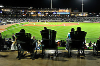 Fans of the Columbia Fireflies watch the action from rocking chairs in the home opener against the Greenville Drive on Thursday, April 14, 2016, the team's first day at the new Spirit Communications Park in Columbia, South Carolina. The Mets affiliate moved to Columbia this year from Savannah. Columbia won, 4-1. (Tom Priddy/Four Seam Images)