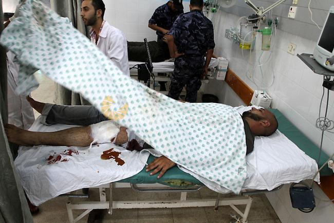 A wounded Palestinian man receives treatment at al-Aqsa hospital in the central Gaza Strip, Thursday, Oct. 7, 2010. An Israeli air strike wounded three Palestinians in the central Gaza Strip, medical officials at Al-Qsa hospital said. Photo by Ashraf Amra