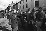Egremont Crabapple Fair, Egremont, Cumbria England 1975. Crabapples are thrown to the assembled crowd. The Bell Ringer Mr P. Pattinson and officials tour the village in the back of a lorry.