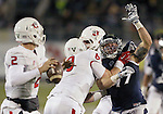 Nevada's Jordan Dobrich (49) tries to block a pass from Fresno State's Brian Burrell (2) during the second half of an NCAA college football game in Reno, Nev., on Saturday, Nov. 22, 2014. (AP Photo/Cathleen Allison)