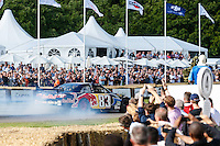 Patrick Friesacher enterains crowds in the Red Bull UK 2007 5.8 litre V8 Toyota Camry at Goodwood Festival of Speed 2016 at Goodwood, Chichester, England on 24 June 2016. Photo by David Horn / PRiME Media Images