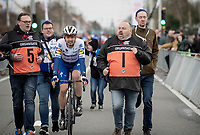 Kasper Asgreen (DEN/Deceuninck - QuickStep) wins the 72nd Kuurne-Brussel-Kuurne 2020 by staying seconds ahead of a chasing/sprinting peloton and is escorted towards the podium afterward<br /> <br /> Kuurne to Kuurne (BEL): 201km<br /> <br /> ©kramon