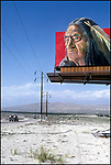 Political billboard protesting the treatment of Native Americans looms over the desert highway near Palm Springs, CA