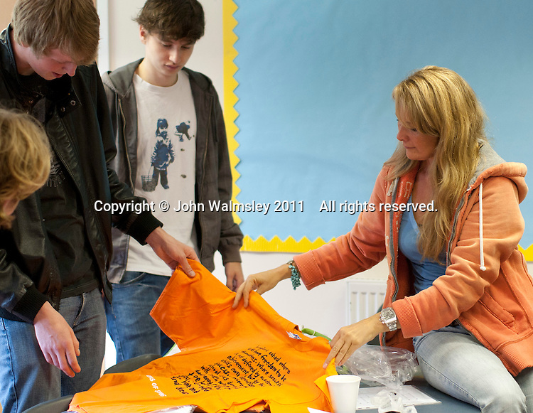 Looking at the new T-shirt on sale at the reunion for Summerhill School's 90th birthday celebrations.