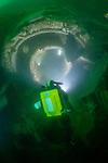 Rebreather diver illuminates a turbine on the SMS König