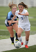 Rogers' Grace Nowlin (3) pushes the ball Tuesday, April 27, 2021, ahead of Springdale Har-Ber's Graci Dunlap during the first half of play at Wildcat Stadium in Springdale. Visit nwaonline.com/210428Daily/ for today's photo gallery. <br /> (NWA Democrat-Gazette/Andy Shupe)