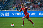 Toni Kroos of Bayern Munich in action during a friendly match against VfL Wolfsburg as part of the Audi Football Summit 2012 on July 26, 2012 at the Guangdong Olympic Sports Center in Guangzhou, China. Photo by Victor Fraile / The Power of Sport Images