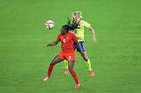 YOKOHAMA, JAPAN - AUGUST 6: Deanne Rose #6 of Canada battles for the ball with Jonna Andersson #2 of Sweden during a game between Canada and Sweden at International Stadium Yokohama on August 6, 2021 in Yokohama, Japan.