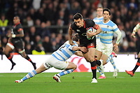 Alex Lozowski of England is tackled by Santiago Gonzalez Iglesias of Argentina during the Old Mutual Wealth Series match between England and Argentina at Twickenham Stadium on Saturday 11th November 2017 (Photo by Rob Munro/Stewart Communications)