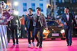 Singer Jay Chou, Ken Chu and his wife Audrey, and Wang Zhongjun walk the Red Carpet event at the World Celebrity Pro-Am 2016 Mission Hills China Golf Tournament on 20 October 2016, in Haikou, China. Photo by Victor Fraile / Power Sport Images
