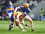 Shane O Donnell of Clare in action against Donagh Maher of Tipperary during their quarter final at Pairc Ui Chaoimh. Photograph by John Kelly.