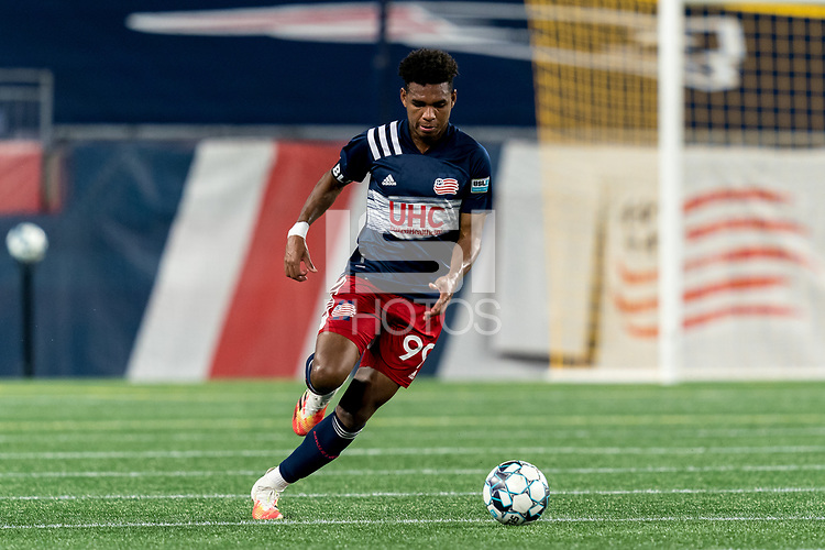 FOXBOROUGH, MA - SEPTEMBER 09: Orlando Sinclair #99 of New England Revolution II brings the ball forward during a game between Chattanooga Red Wolves SC and New England Revolution II at Gillette Stadium on September 09, 2020 in Foxborough, Massachusetts.