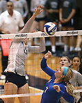 Nevada's Sam Willoughby hits against Air Force's Hillary Keltner during college volleyball action in Reno, Nev., on Thursday, Sept. 25, 2014. Air Force won 3-2.<br /> Photo by Cathleen Allison
