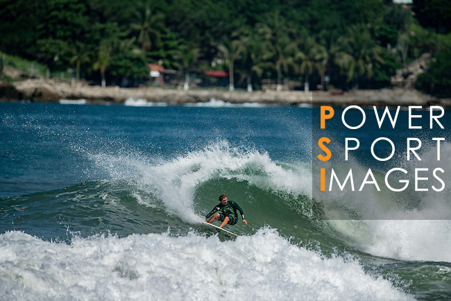 Surfer rides a wave at Puerto Escondido's Zicatela Beach in Mexico. Photo by Victor Fraile / Power Sport Images