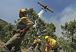 """SPAIN, Parras : A member of the fire brigade """"Romeo 10"""" of Segovia works around a fire in Parras, near Avila during the forest fires in the region, on July 29, 2009. A man died in a wildfire on July 28, when flames swept through a house in western Spain, the first civilian death in blazes that also claimed the lives of six Spanish firefighters last week, authorities said.  on July 29, 2009. (C) Pedro ARMESTRE"""
