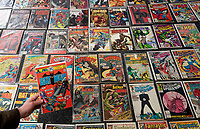 BNPS.co.uk (01202 558833)<br /> Pic: ZacharyCulpin/BNPS<br /> <br /> The collection includes Superman, Batman, X-men, Spiderman, Fantastic Four and Avengers comics<br /> <br /> A huge comic collection immaculately accumulated over 60 years by a late fanatic has been found by his family. <br /> <br /> The vast archive of over 8,000 comics was amassed by bachelor Peter James who kept them in pristine condition at his home.<br /> <br /> He was introduced to comics by his mother as a young boy as she thought it would encourage him to read.<br /> <br /> He started collecting at the age of 10 and kept the magazines neatly stacked in boxes.