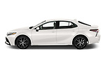 Car Driver side profile view of a 2021 Toyota Camry SE 4 Door Sedan Side View