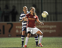 20130906 - OOSTAKKER , BELGIUM : PSV's Danielle Van De Donk pictured with Gent's Nina Vindevoghel in the back during the female soccer match between AA Gent Ladies  and PSV / FC Eindhoven Dames , of the third matchday in the BENELEAGUE competition. Friday 06 th September 2013. PHOTO DAVID CATRY