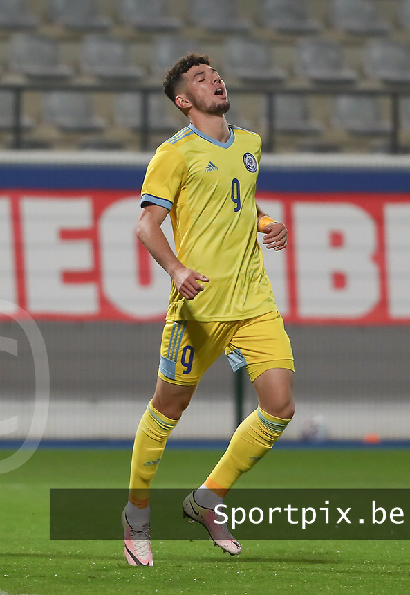 Elkhan Astanov (9) of Kazakhstan is disappointed with is missed chance during a soccer game between the national teams Under21 Youth teams of Belgium and Kazakhstan on the third matday in group I for the qualification for the Under 21 EURO 2023 , on friday 8 th of october 2021  in Leuven , Belgium . PHOTO SPORTPIX | SEVIL OKTEM