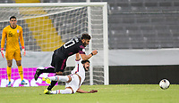 GUADALAJARA, MEXICO - MARCH 24: Mauricio Pineda #5 of the United States takes a tumble during a game between Mexico and USMNT U-23 at Estadio Jalisco on March 24, 2021 in Guadalajara, Mexico.