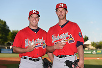 Mississippi Braves pitchers J.R. Graham (34) and Aaron Northcraft (28) pose for a photo before a game against the Montgomery Biscuits on April 21, 2014 at Riverwalk Stadium in Montgomery, Alabama.  Montgomery defeated Mississippi 6-2.  (Mike Janes/Four Seam Images)