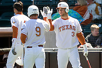 Texas Longhorn catcher Cameron Rupp (3) greets Tant Sheppard (9) after scoring against Nebraska on Sunday March 21st, 2100 at UFCU Dish-Falk Field in Austin, Texas.  (Photo by Andrew Woolley / Four Seam Images)