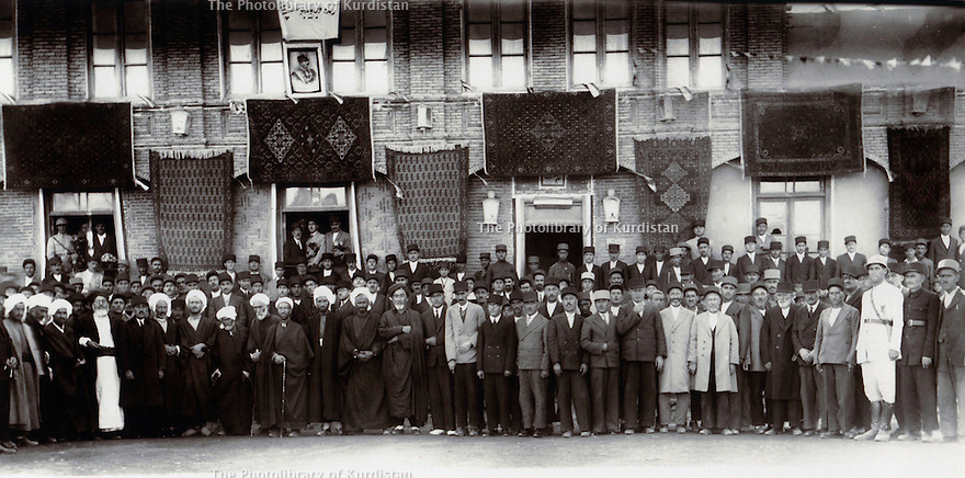 Iran 1935 .In Mahabad,  4th from left, Qazi Sheikh Hussein and 7th from left, Qazi Mohammed with people of the city .Iran 1935 .A Mahabad, 4eme a Gauche, Qazi Sheikh Hussein et 7eme a gauche, Qazi Mohammed lors d'un rassemblement