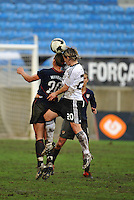 Abby Wambach challenges a German player on a header. The USA captured the 2010 Algarve Cup title by defeating Germany 3-2, at Estadio Algarve on March 3, 2010.