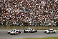 Ron Boucharrd 47 Benny Parsons 55 Buddy Baker 88 action Pepsi Firecracker 400 at Daytona International Speedway in Daytona Beach, FL on July 4, 1985. (Photo by Brian Cleary/www.bcpix.com)