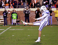 CHARLOTTESVILLE, VA- NOVEMBER 12: Punter Alex King #36 of the Duke Blue Devils punts the ball during the game against the Virginia Cavaliers on November 12, 2011 at Scott Stadium in Charlottesville, Virginia. Virginia defeated Duke 31-21. (Photo by Andrew Shurtleff/Getty Images) *** Local Caption *** Alex King
