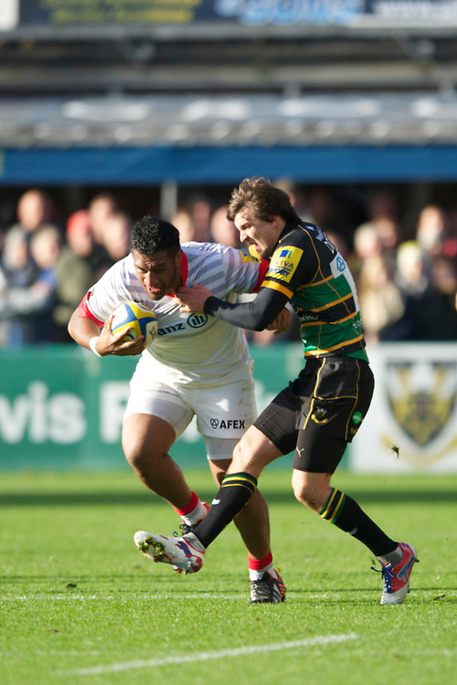 20121027 Copyright onEdition 2012©.Free for editorial use image, please credit: onEdition..Mako Vunipola of Saracens is tackled by Lee Dickson of Northampton Saints during the Aviva Premiership match between Northampton Saints and Saracens at Franklin's Gardens on Saturday 27th October 2012 (Photo by Rob Munro)..For press contacts contact: Sam Feasey at brandRapport on M: +44 (0)7717 757114 E: SFeasey@brand-rapport.com..If you require a higher resolution image or you have any other onEdition photographic enquiries, please contact onEdition on 0845 900 2 900 or email info@onEdition.com.This image is copyright the onEdition 2012©..This image has been supplied by onEdition and must be credited onEdition. The author is asserting his full Moral rights in relation to the publication of this image. Rights for onward transmission of any image or file is not granted or implied. Changing or deleting Copyright information is illegal as specified in the Copyright, Design and Patents Act 1988. If you are in any way unsure of your right to publish this image please contact onEdition on 0845 900 2 900 or email info@onEdition.com