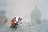 St Petersburg, Russia, January 2003..A passenger stares through a frozen trolley bus window on Nevsky Prospect as winter temperatures plunged to -35C..