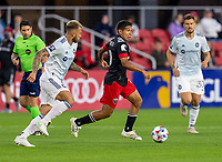 WASHINGTON, DC - MAY 13: Edison Flores #10 of D.C. United dribbles during a game between Chicago Fire FC and D.C. United at Audi FIeld on May 13, 2021 in Washington, DC.