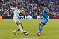 KANSAS CITY, KS - MAY 29: Khiry Shelton #11 of Sporting KC attempts to get around Memo Rodriguez #8 of Houston Dynamo FC during a game between Houston Dynamo and Sporting Kansas City at Children's Mercy Park on May 29, 2021 in Kansas City, Kansas.