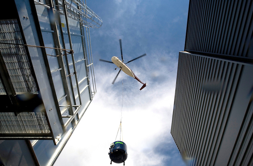 A helicopter lifts 2 filters onto the roof of the new Sands casino in Bethlehem on Friday August 8th. Photography by Chuck Zovko