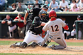 April 11, 2010:  Catcher Kris Watts of the Altoona Curve tags out Bill Rhinehart as umpire David Soucy looks on during a game at Blair County Ballpark in Altoona, PA.  Altoona is the Double-A Eastern League affiliate of the Pittsburgh Pirates.  Photo By Mike Janes/Four Seam Images