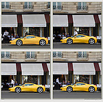Waiter at French restaurant looking at yellow Ferrari, Paris, France,